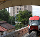 A red monorail train in Kuala Lumpur is a quick and cheap method of transport around the central