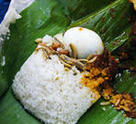 Nasi Lemak: Wrapped in banana leaves; both the dish and the package!